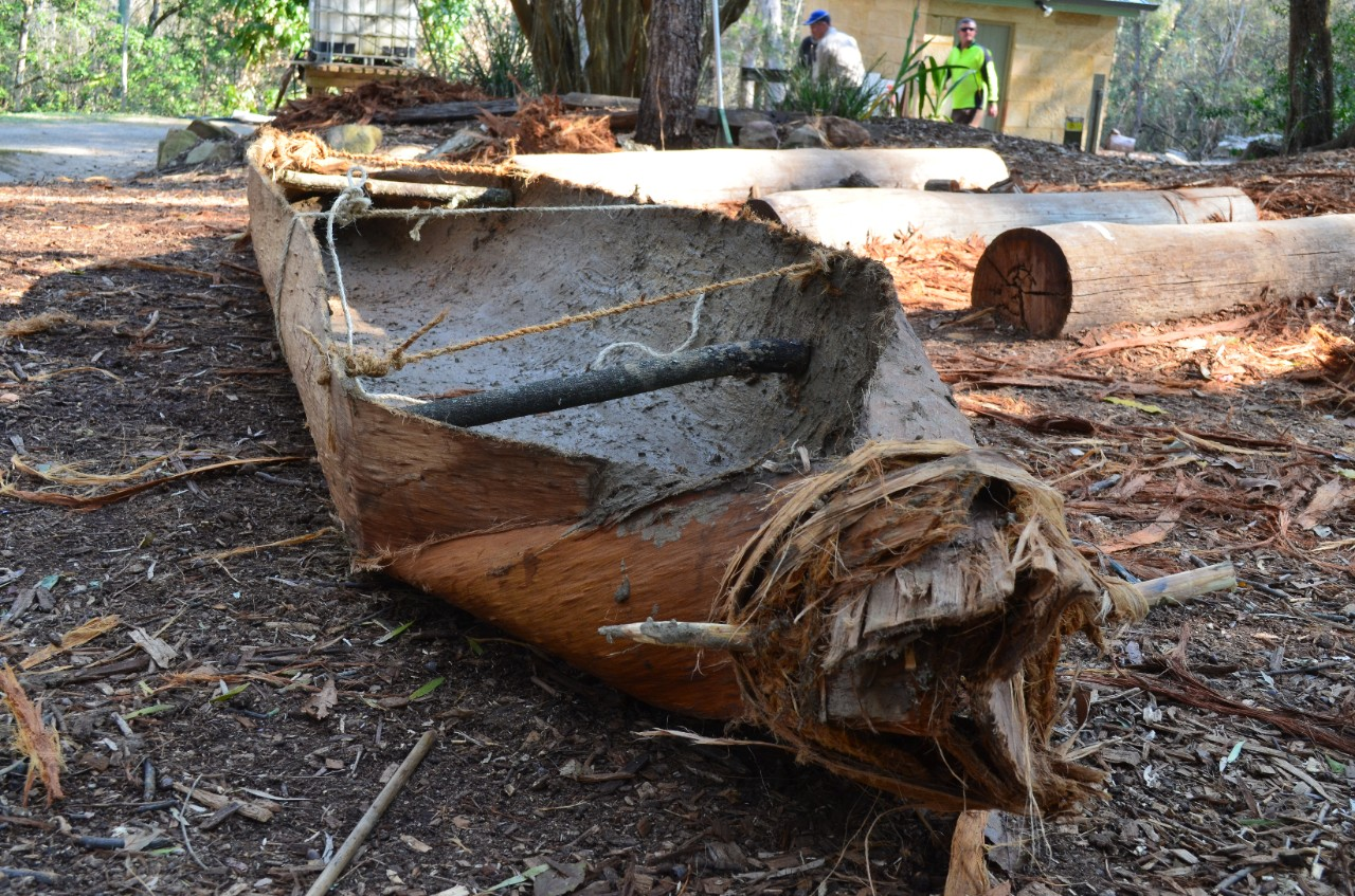 image of Aboriginal canoe made out of stringy bark, lined with mud