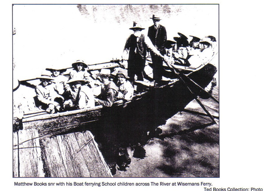 Old image from the Ted Books Collection showing Matthew Books on his boat ferrying students.