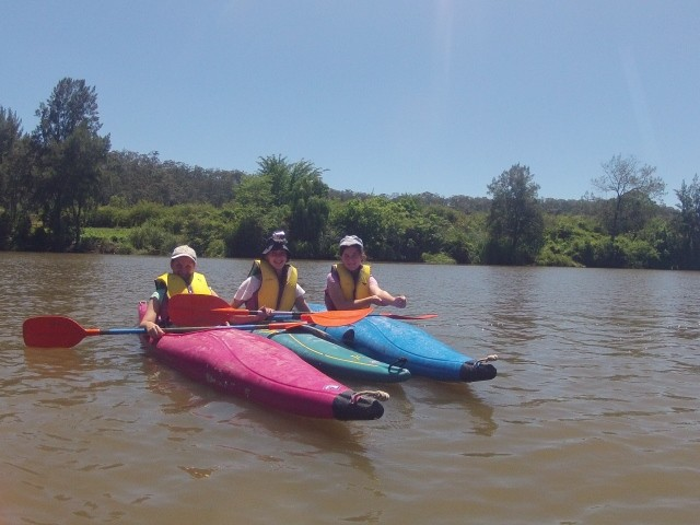 students kayaking on the river